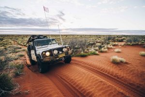 4Wd on red sand desert